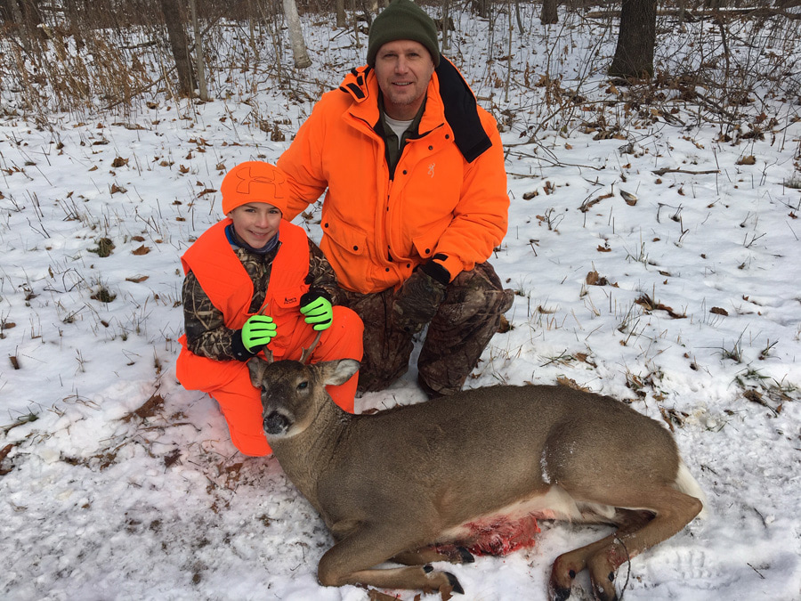 Sam, age 12, of Hudson, WI shot his first deer this year on his grandfather's property near Cumberland. His grandfather is fighting Parkinson's so was unable to take Sam hunting - neither of Sam's parents hunt so his uncle, Eric Reed, flew in from Lancaster, PA to take Sam out for the Wisconsin gun deer season! Unsure if Eric would be able to make it, Sam and his mom, Amanda, watched many YouTube videos on how to field dress a deer in case Sam got lucky. In the end, Sam made a good shot and they were able to find the deer right away. - Photo credit: Contributed
